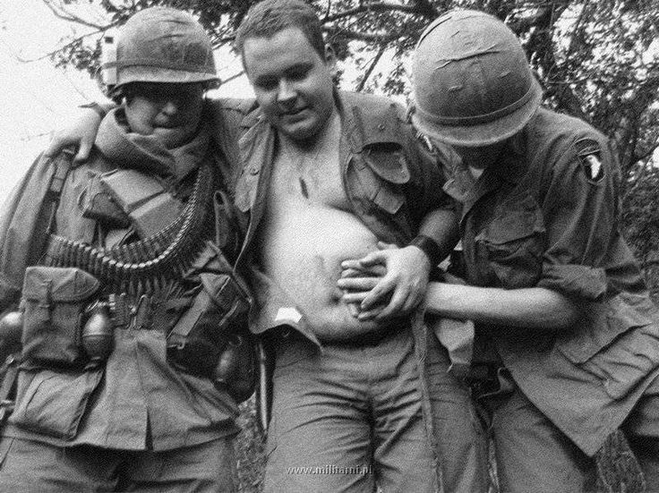 dog ate my tank - 1969US soldiers of the 101st Airborne Division with a wounded comrade during the Battle of Hamburger Hill, Dang Ap Bia, Vietnam