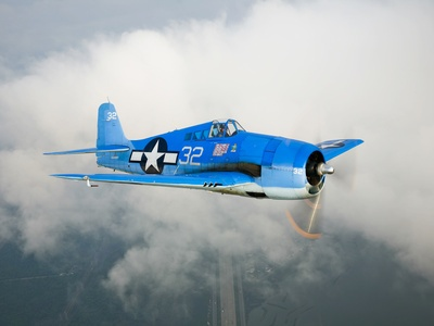 A Grumman F6F Hellcat Fighter Plane in Flight The Hellcat. Introduced in 1943 as…