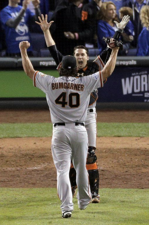 Giants Madison Bumgarner and Buster Posey celebrate after the Giants make the final out of the game, winning game seven of the World Series against the Kansas City Royals at Kauffman Stadium in Kansas City, Missouri, on Wednesday Oct. 29, 2014.
