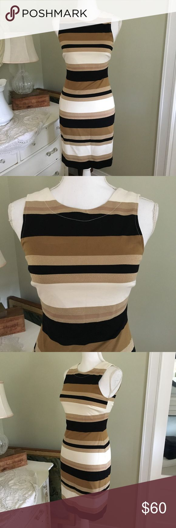 "NWT Banana Republic Stripe Cocktail Dress This NWT gorgeous dress from Banana Republic is sleeveless and features black, cream and tan horizontal stripes, a V shaped back and back zipper. Size: 2P. Chest: 14.75"". Waist: 13"". Length: 35.25"". Banana Republic Dresses Midi"