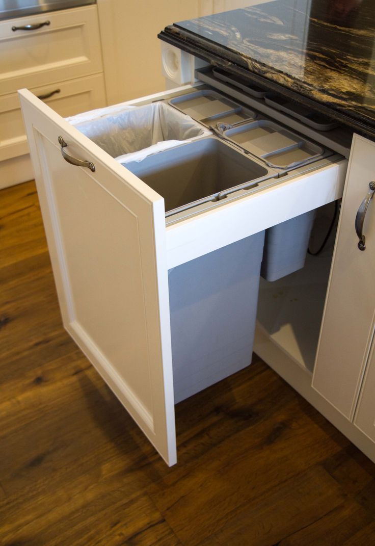 In drawer bins with built in lid (by Hafele). www.thekitchendesigncentre.com.au