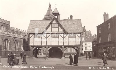The Old Grammar School in Market Harborough, around 1920. Built in 1614 and funded by Robert Smyth, the Old Grammar School is one of Market Harborough's most instantly recognisable landmarks.   The beautiful timber structure was built on posts to keep people dry in times of bad weather and to allow the butter market to continue to be held. The Grammar School underwent a renovation in 1789, an extension in 1869 and a £30,000 restoration in 1977.