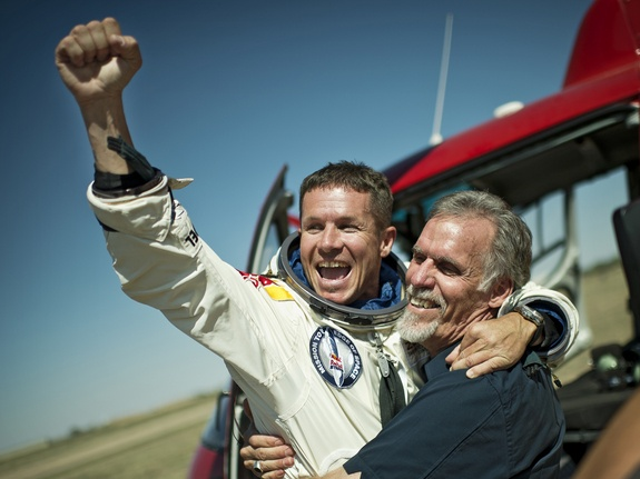 Highest Skydive: Triumph  Skydiver Felix Baumgartner of Austria and Technical Project Director Art Thompson of the Unites States celebrate after successfully completing the worlds highest skydive, a supersonic leap, for Red Bull Stratos in Roswell, New Mexico, on Oct. 14, 2012