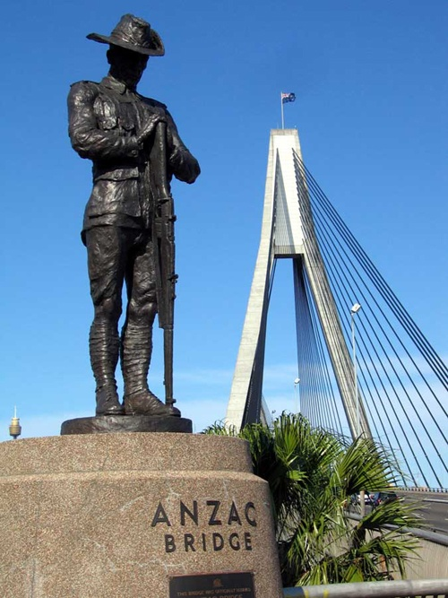 The statue of the Australian diigger at the end of Anzac Bridge in Sydney, stands opposite a statue of a New Zealand digger.