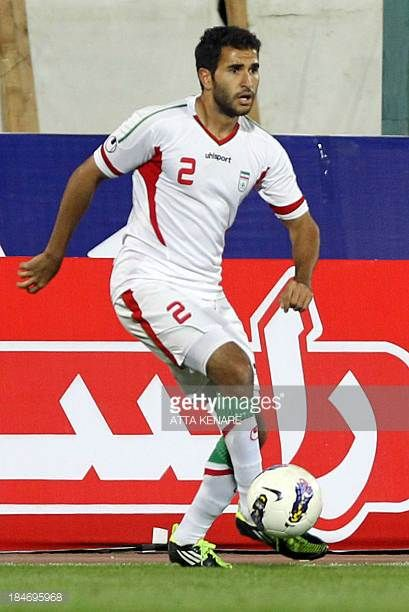 Mehrdad Beitashour of Iran kicks the ball during their 2015 AFC Asian Cup group B qualifying football match against Thailand at the Azadi Stadium in...