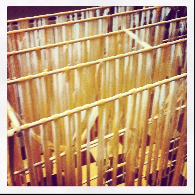 Handmade pasta hanging up to dry.
