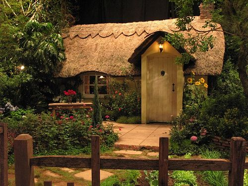Little thatched cottage.  I'm not sure if this is a miniature, or a real very small cottage.  Either way it's perfect.  I'd love to live right here.