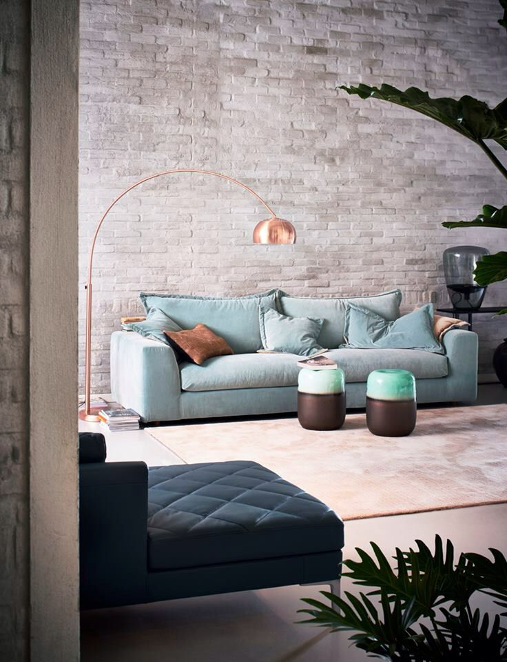 Living room inspriation colorful pastel sofa with copper lamp and brick wall