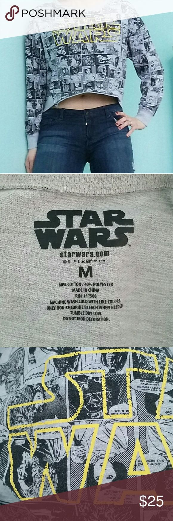 Star Wars Cropped Graphic Sweatshirt Grey M This is a cute cropped graphic sweatshirt in size M medium. It has a distressed yellow Star Wars graphic on the front. It is grey with black comic strips all over it. It is in good, used condition- any signs of wear may be seen by photos. Approximate measurements shown. Offers welcome! Thank for looking! ☺ Star Wars Tops Crop Tops