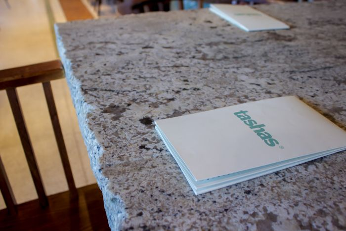 We love the flamed granite at tashas V&A Waterfront, Cape Town!  Get an AMAZING selection of granite, marble and onyx slabs from www.rudischoice.co.za in South Africa and Zimbabwe.