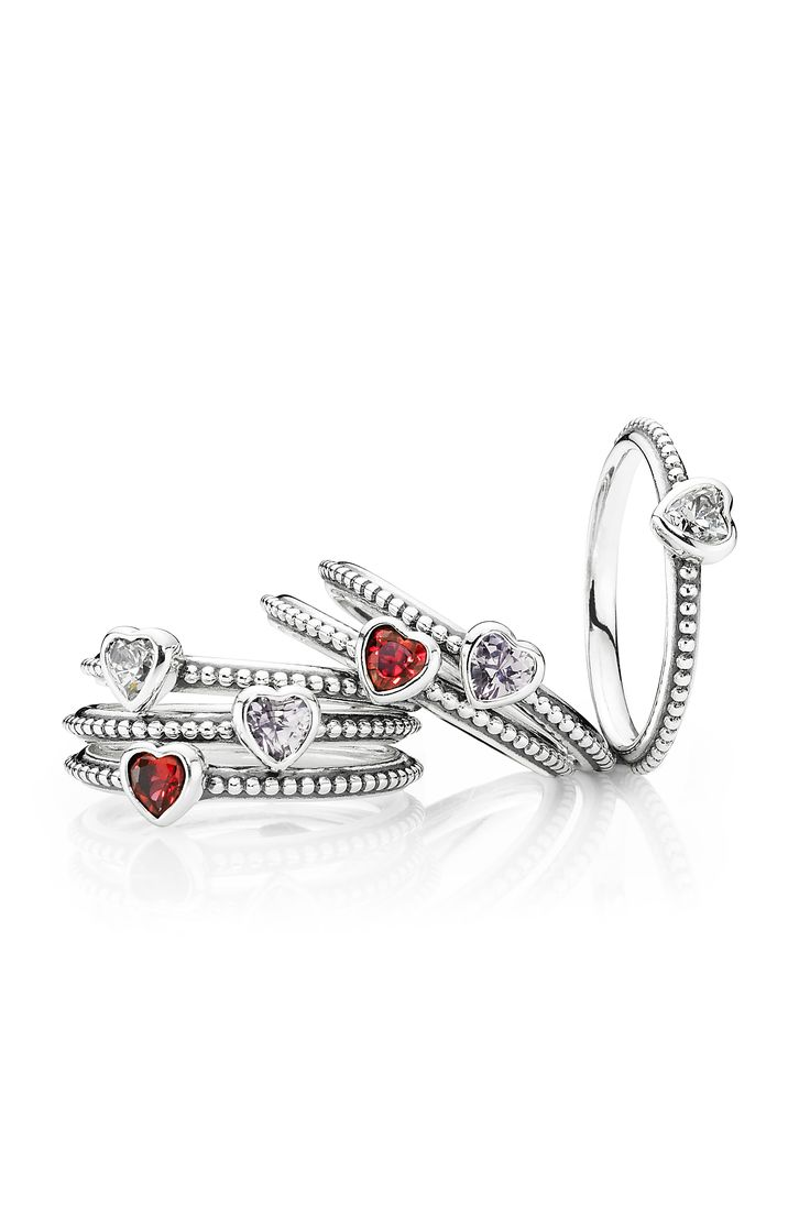 These cute heart-shaped rings are perfect as friendship rings. Available in three different colors; red, subtle rose pink and clear. #PANDORA #PANDORAring