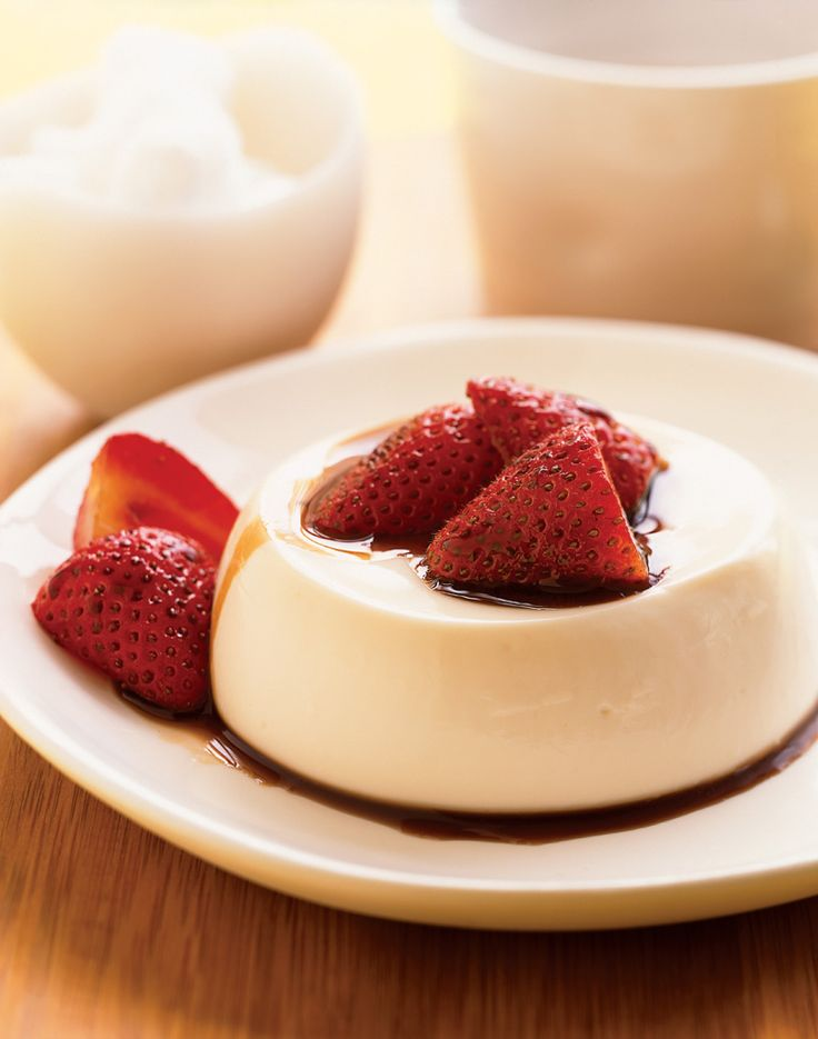 Panna cotta, a not-too-sweet dessert made from cream, buttermilk, sugar and gelatin, is popular all over Italy, served with berries, caramel or chocolate. Our recipe has you marinate strawberries in balsamic vinegar; the syrupy fruit juices add a zippy, tangy edge to the smooth custard.