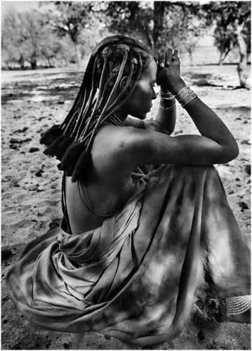 "Africa | ""Himba woman in Orutanda, in a group composed of almost exclusively women, the men had gone far with the cattle herd in search of water and pasture. Kaokoland. Namibia"" 