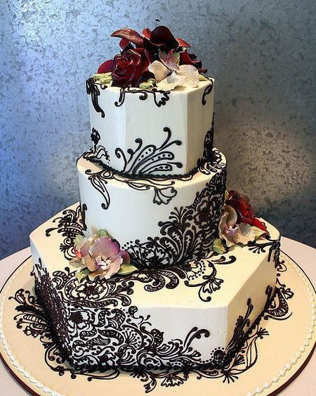 I love how the lact flows up the cake, and the layers are different shapes. It is unique.  indianweddingsmag.com
