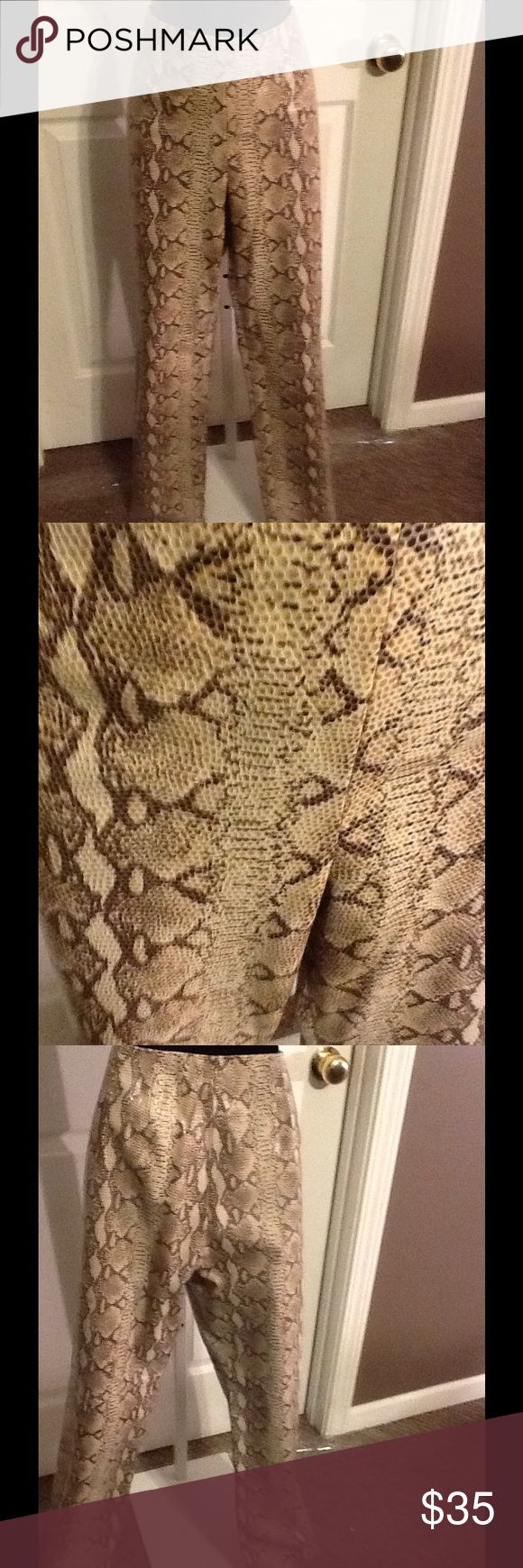 Dana Buchman Snake print pants. These Dana Buchman Python print pants are 100% Lamb skin and bad to the bone you will be hard pressed to find these exquisite pants for such a great price and great condition. Dana Buchman Pants