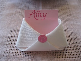 "Place cards for a baby shower: ""diapers"" made of paper towel"