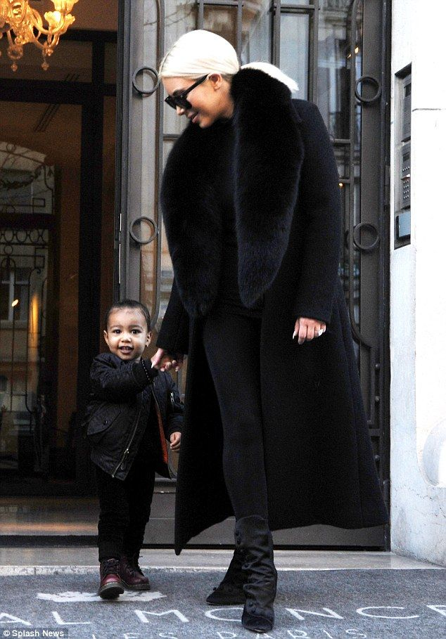 Look who's back! Kim Kardashian emerged from her hotel, Le Royal Moncaeau in Paris on Thursday with her adorable daughter North West