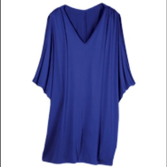 Top Blue  Batwing Top Polyester with spandex. Machine wash and dry. Imported. Tops