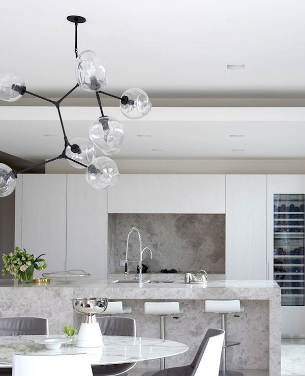 Contemporary white kitchen with grey stone detailing