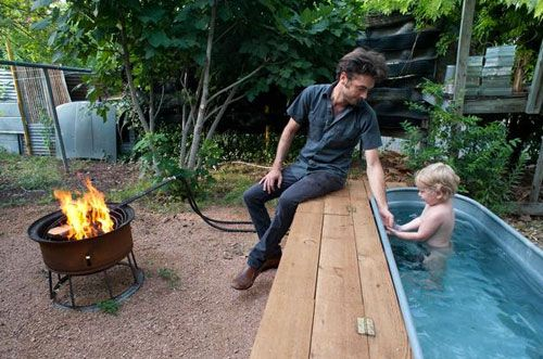 A 5-foot galvanized cattle trough connected to a heat lamp and a water pump that can be transformed into a wood-fired hot tub.THIS IS AWESOME