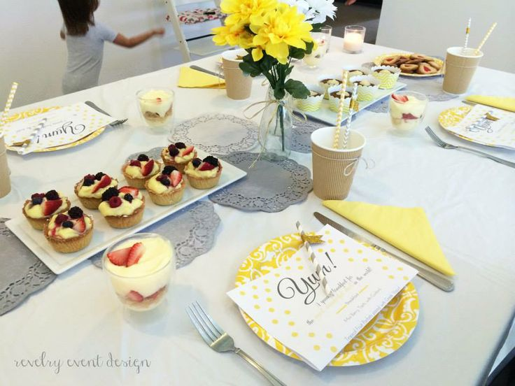 Father's Day breakfast table | yellow and grey theme | rustic | doilies | diy doilies | grey doilies | carrot cupcakes | berry tarts | striped straws | father's day menu | fruit parfaits | by Revelry Event Design