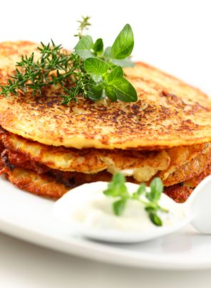 Potato Pancakes from grated potatoes, onion, garlic cloves, eggs, flour, marjoram (or parsley?), salt and pepper