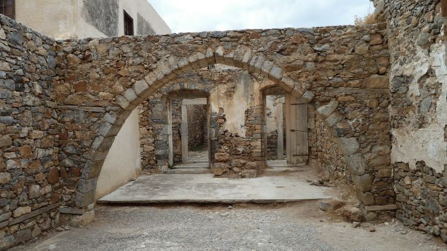Abandoned structures in Spinalonga in Crete, Greece. The island was a Venetian fortress and leper colony. (Credit: Wikimedia Commons/Deror_avi