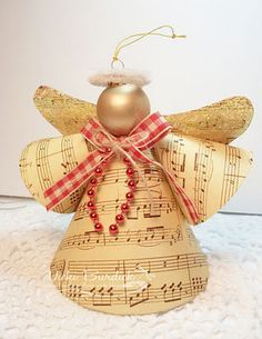 Music angel.....or you could use same concept & make out of recycled Christmas Cards....like!