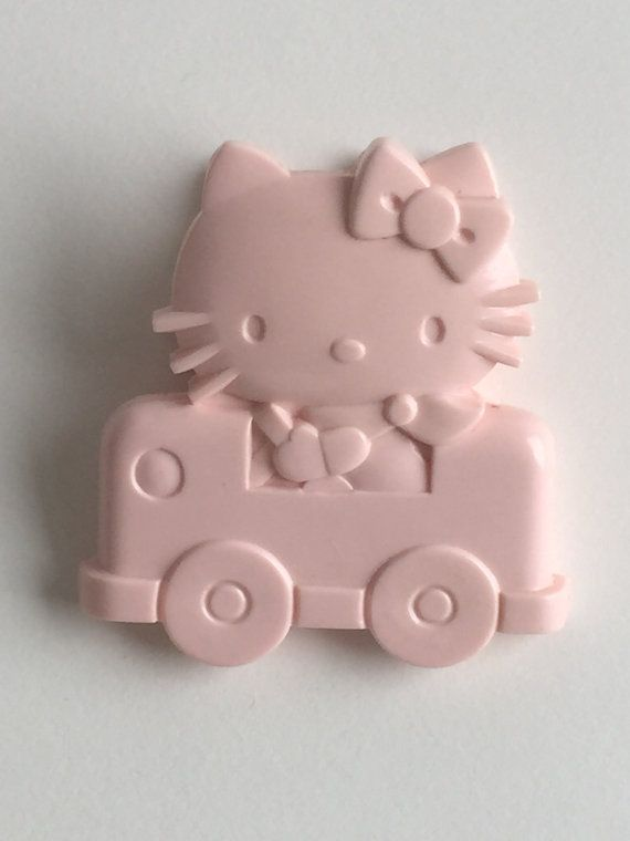 Rare 1 Pink Hello Kitty by Sanrio is looking so fine in her buggy.  This piece is a collector piece from the 1976 Collection:) Beautiful!