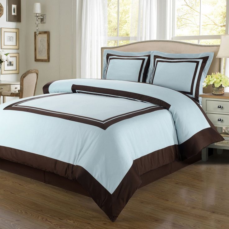 Modern Hotel Style Blue and Brown 100 percent Egyptian Cotton Framed Duvet Cover and Shams Set. Made of 300 thread count soft egyptian cotton. The bedding set is contrasted with a Brown frame pattern for a chic 5 Stars hotel look.