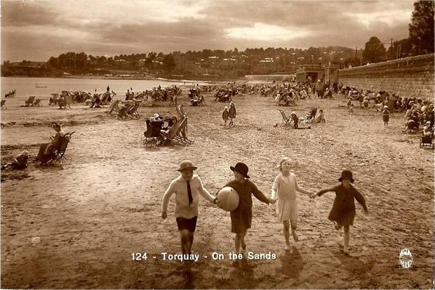 Torquay, on the sands - in Devon, England, in the 1920s.