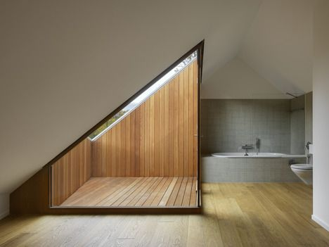 Clavien Rossier // Two in one house // bathroom with sloppy roof