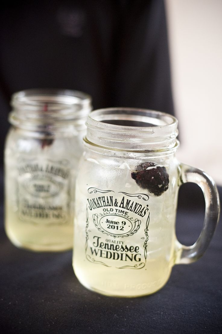 Guest party favor - Mason jars with wedding logo and signature cocktail - Lynchburg Lemonade w/ blackberries. Jars designed by brother of the bride - Matt Rowland. Photo by Jennie Andrews Photography.
