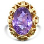 Original 1940s-1950s Amethyst ring, set in 14ct Yellow gold, with fine intricate details around the stone.