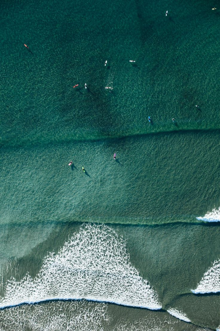 People learning to surf in Tofino, British Columbia, Canada. Photo by Jeremy Koreski