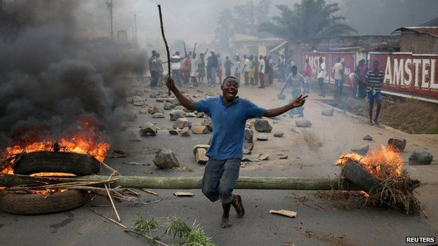 "A protester dances in front of a barricade during a protest against Burundi""s President Pierre Nkurunziza and his bid for a third term in Bujumbura, Burundi, May 22, 2015"