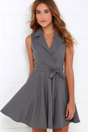 Rain or shine, day or night, the Singing in the Rain Sleeveless Grey Dress will have you bursting into song! A structured sleeveless dress with a surplice bodice is shaped by lightweight woven fabric in a lovely grey hue. Notched lapels and a tying sash belt give this dress a cute trench coat-inspired look while a flirty skater skirt flares below! Hidden side zipper. Bodice is lined. Self: 80% Polyester, 16% Rayon, 4% Spandex. Lining: 100% Polyester. Hand Wash Cold. Imported.