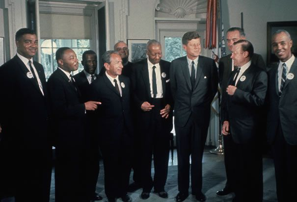 Kennedy with Civil Rights leaders: Kennedy supported Civil Rights though it wasn't until after his death that major legislation passed.