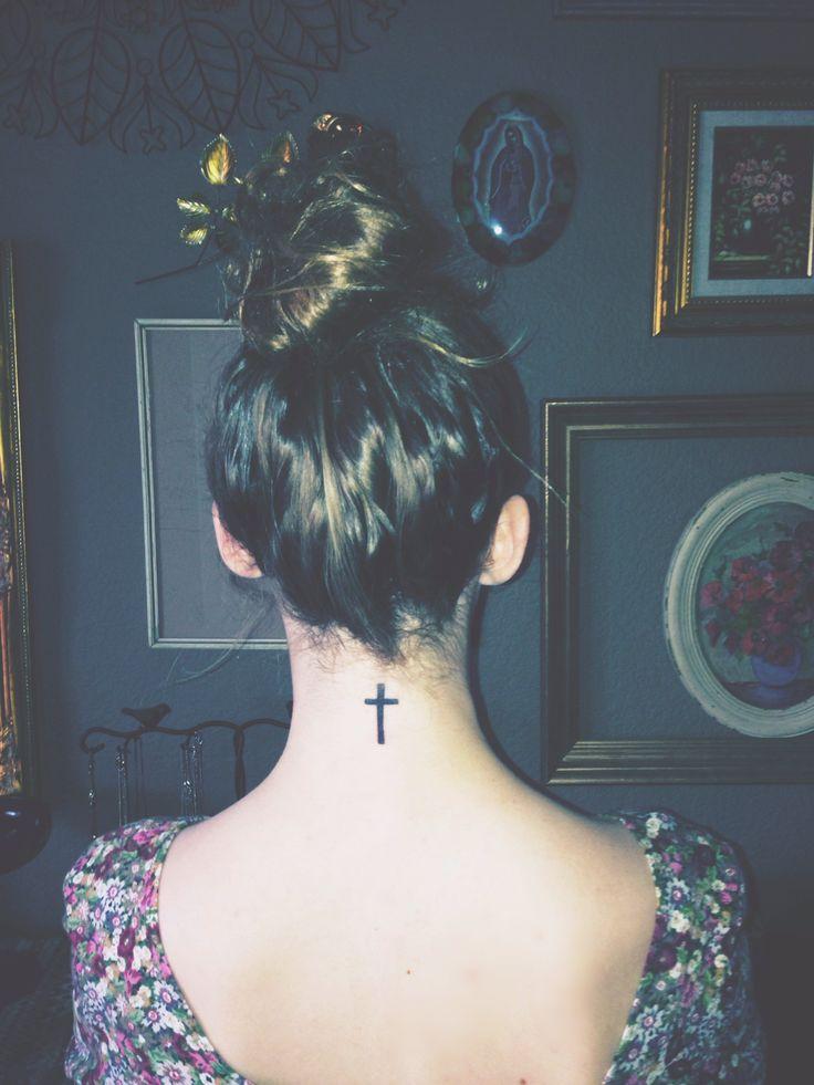 Cross neck tattoo