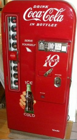 Vintage Coca Cola Soda Vending Machines...put money in and pull out a coke....there was one just like this in our city library.   Such a treat!