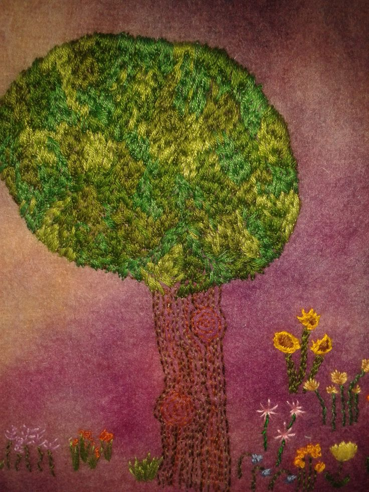 close up showing stitch detail of 'The Tree' all free hand stitched on hand made felt
