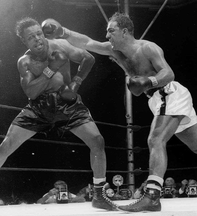 Rocky Marciano KO 9 Archie Moore September 21, 1955 Marciano came off the canvas to score a ninth-round of knockout of Moore, the light heavyweight champion who had moved up in weight. It was the last fight of Marciano's career. He remains the lone heavyweight champion to retire undefeated.