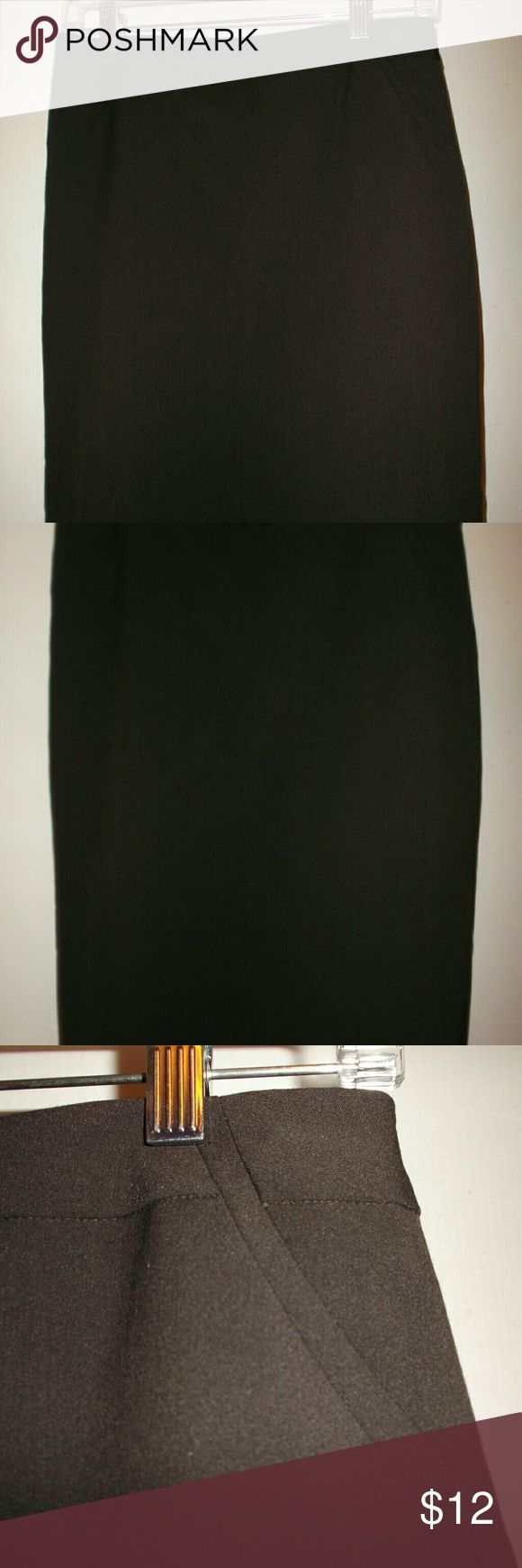 """Curvy Fit Chocolate Brown Pencil Skirt Womens 4 New with tags!   A classic style skirt by Worthington.   The color is called """"Deep Chocolate """" on the tag.  73 % polyester   23 % rayon,  4 % Spandex fabric.   Machine washable,   Left side zip.   The back is very cute with 2 rows of functional buttons near the bottom hem.   No functional pockets,  fully lined.   Measures 14 3/4 inches across the waist in front,   22.5 inches waist to bottom hem Worthington Skirts Pencil"""