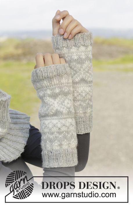 Bonnet, tour de cou et chauffe-poignets DROPS avec jacquard norvégien, en Karisma. Modèle gratuit de DROPS Design.