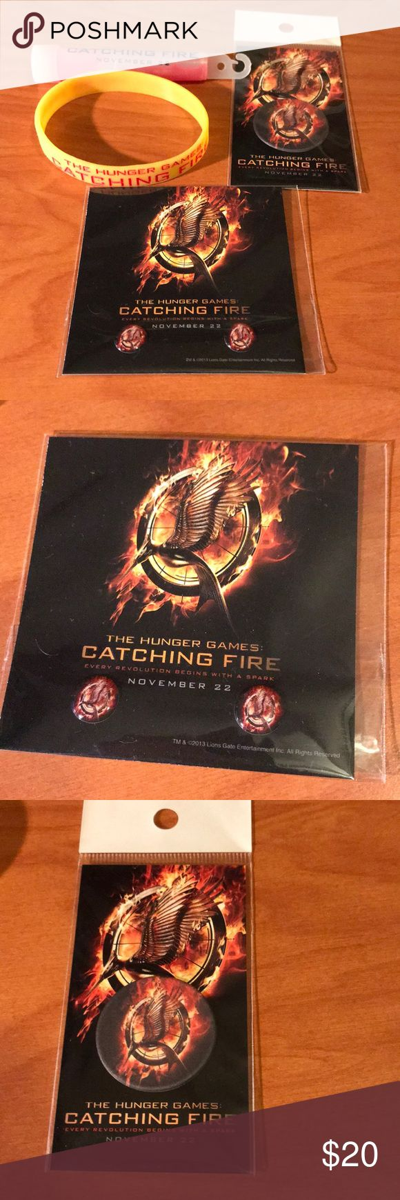 The Hunger Games catching fire fan camp set of 4 All items are brand new, you will receive 1 glow stick (hasn't been broken yet) 1 bracelet, home button stickers, and screen cleaner. This post is a FIRM price. Other