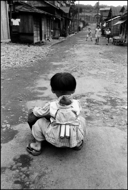 Werner Bischof JAPAN. Girl with puppet. 1951.