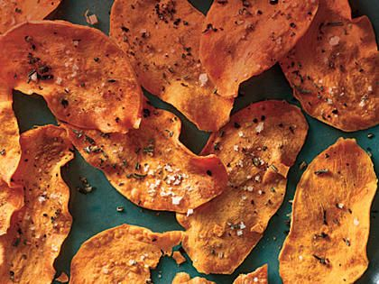Microwave Sweet Potato Chips | When the chip craving strikes, look no further than these healthy, homemade chips. Pro tip: You'll need a mandoline to slice the potato thin enough to crisp.