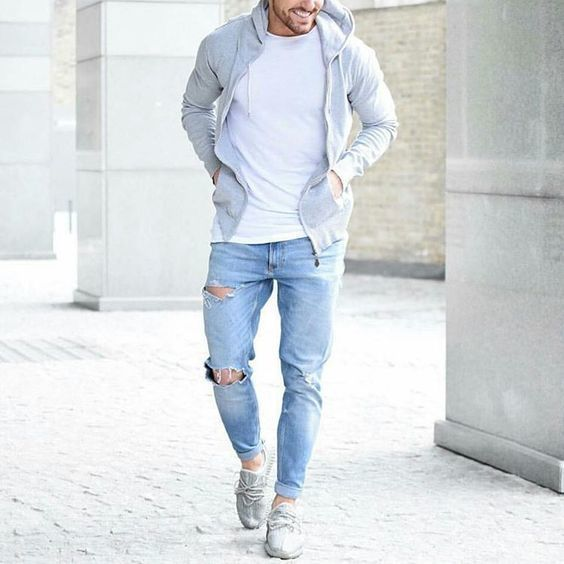 Shop this look on Lookastic: https://lookastic.com/men/looks/grey-hoodie-white-crew-neck-t-shirt-light-blue-jeans/19829   — White Crew-neck T-shirt  — Grey Hoodie  — Light Blue Ripped Jeans  — Grey Canvas Espadrilles