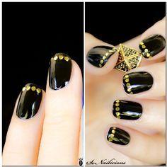 black nail art - gold dots