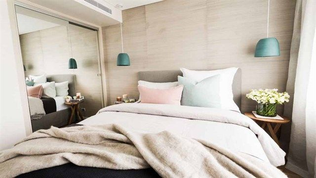 The pastel colours gave the room a relaxed feel.